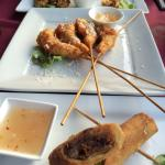 Small plates 1/2 price during happy hour!  Fried artichoke, coconut shrimp, and spring rolls. YU