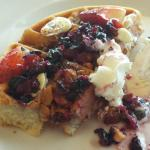 Fabiani's Waffle with berries, macademia nuts, white chocolate, whipped cream and syrup.
