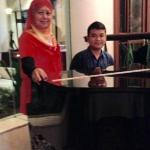 With the obliging resident pianist