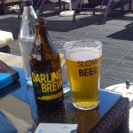 A goad, local beer at the sun-deck
