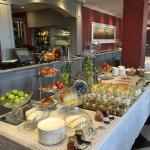 Breakfast cold buffet, with fresh fruit, cereals, breads, yogurt, etc.
