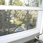 the view out of one of the two large street-side windows