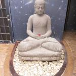 Buddha located in front of Niche