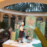 One of the talented chef/bakers creating a giant gingerbread house in the main Cloisters atrium