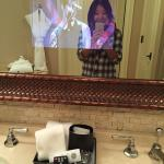Yes that's a TV in the bathroom mirror!