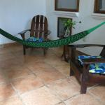 Hammock and chairs, private patio outside one of the rooms