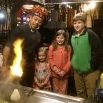 The chef treats my children to a fiery hot treat!