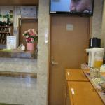 Reception desk is in front of a complimentary breakfast served
