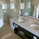 Well-designed bathroom with a large shower; hand-held and rainfall shower heads.
