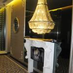 Chandelier on each floor with faux fireplace! Nice touch