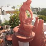 Terrace garden pieces add to the ambiance on the rooftop.