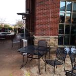 Partial view of outdoor patio area with heaters.