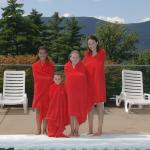 Kids at the outdoor pool with the mountains in the distance