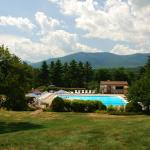 View from the resort of the outdoor pool and mountains