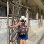 Outside the barbed wire-enclosed building