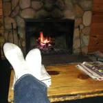 Putting my feet up in the living room, enjoying the fire