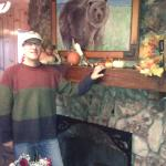 Me in front of the wonderful fireplace in the lobby