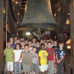 Schoolchildren posing under the Church Bell Maria from 1505. Photo by Tommie Hendriks.