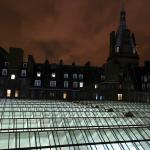 Night view of the glass roof of Glasgow station.