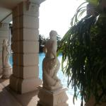 The Italian sculptures surrounding the large outdoor pool are an elegant accent