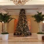 Lobby Christmas Tree in the middle of 2 palm trees