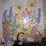 The flower mosaic in the kitchen over the sink