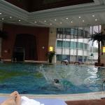 Spacious indoor pool looking towards entrance from hotel
