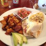Three egg burrito with cheddar and bacon! Cappuccino!