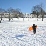 Sledding on the resort's front lawn