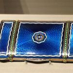 Enameled cigarette case scrubbed to appear as silk.