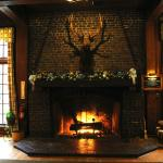 The roaring fire in the main lodge with Christmas decor.