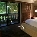 Bedroom in Ambassador king suite; note balcony with view completely blocked by trees.