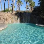 Waterfall into large pool at the water park.