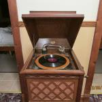 Antique record player in the hallway.