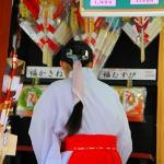gift shop lady, wearing traditional shinto shrine dress