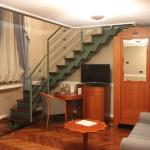 Stairs to the 2nd level, mini bar, wardrobe