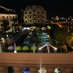 view of pool and hotel at night from balcony