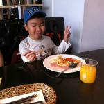 Pancake, french toast, pizza and orange juice for breakfast
