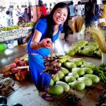 Lisa at the Town market where fruits and vegies are very cheap.