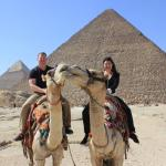 Riding camels in front of pyramids! Life is good!!