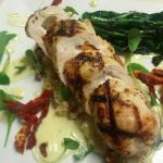 Chicken roulade stuffed with fresh mozzarella and sundried tomatoes, over Mediterranean cous cou