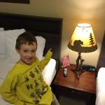 Boy is very impressed by the U.P. lamp and the clock with phone charging outlets.