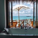 View from bathtub in water villa