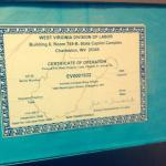 A close up of the elevator certificate