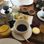 Impressive French pressed coffee, orange juice, a fresh fruit platter for 2, and freshly brewed