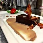 flourless chocolate cake. candied bacon. bourbon caramel. chantilly cream