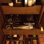 Fully stocked. The coffee is nice. There is also a cork opener in the room.