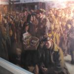 Painting of troops waiting to board a train