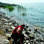 Me collecting pebbles on the shore