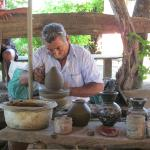 A local potter demonstrating his craft, passed down from his father